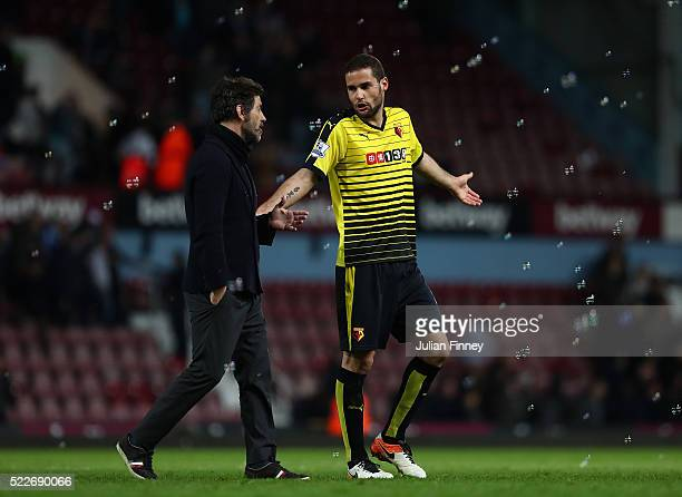 Mario Suarez of Watford in conversation with Quique Flores manager of Watford during the Barclays Premier League match between West Ham United and...