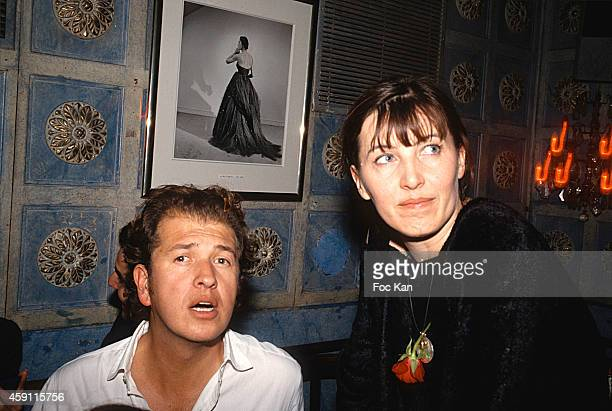 Mario Testino and a guest attend a fashion week Party at Les Bains Douches in the 1990s in Paris France