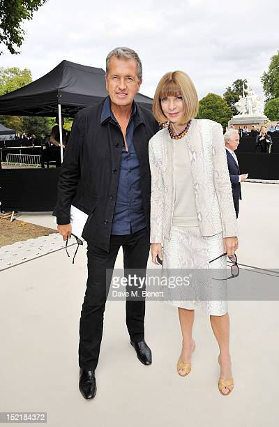 Mario Testino and Anna Wintour arrive at the Burberry Spring Summer 2013 Womenswear Show during London Fashion Week on September 17 2012 in London...