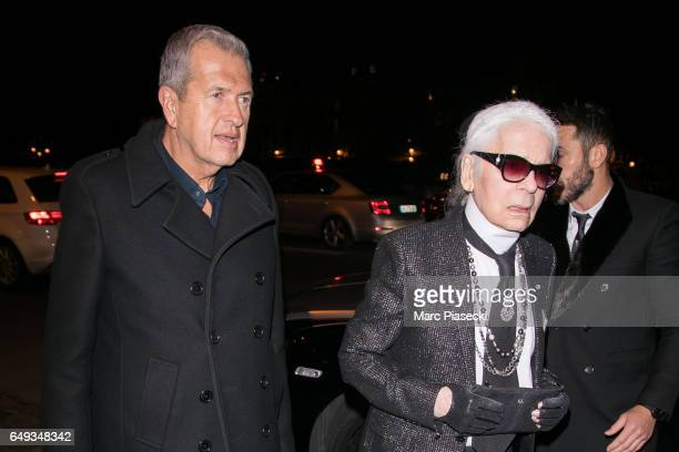Mario Testino and Karl Lagerfeld arrive to attend the 'V Magazine' dinner at Laperouse restaurant on March 7 2017 in Paris France