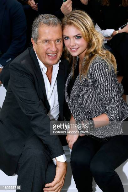 Mario Testino and Kate Upton attend the Chanel show as part of the Paris Fashion Week Womenswear Spring/Summer 2014 held at Grand Palais on October 1...