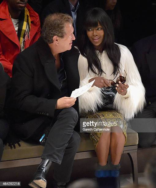 Mario Testino and Naomi Campbell attend the Burberry Prorsum AW 2015 show during London Fashion Week at Kensington Gardens on February 23, 2015 in...