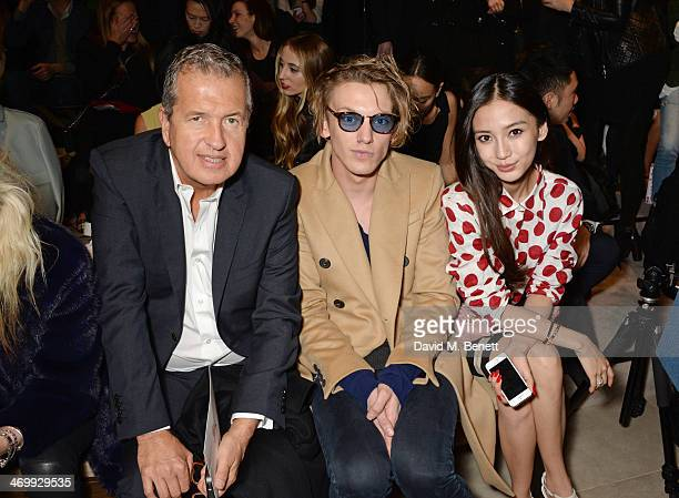 Mario Testino Jamie Campbell Bower and Angelababy attend the front row at Burberry Womenswear Autumn/Winter 2014 at Kensington Gardens on February 17...