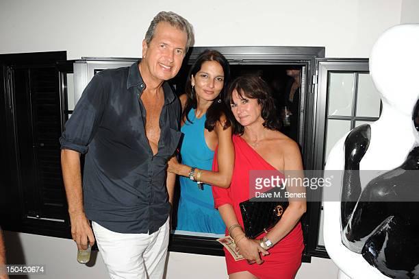 Mario Testino Yasmin Mills and Miranda Davis attend the Ibiza Summer Party In Aid Of Teenage Cancer Trust and Asociacion Espanola Contra El Cancer at...