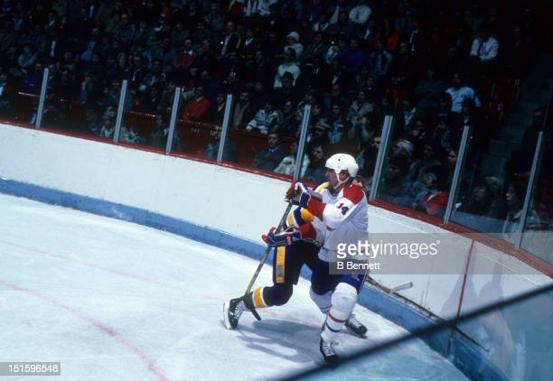 Mario Tremblay of the Montreal Canadiens avoids the check during an NHL game against the Los Angeles Kings on January 6 1983 at the Montreal Forum in...