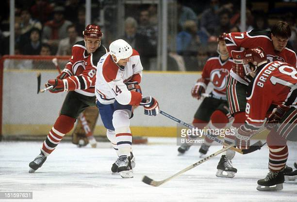 Mario Tremblay of the Montreal Canadiens tries to pass during an NHL game against the New Jersey Devils on December 28 1985 at the Montreal Forum in...