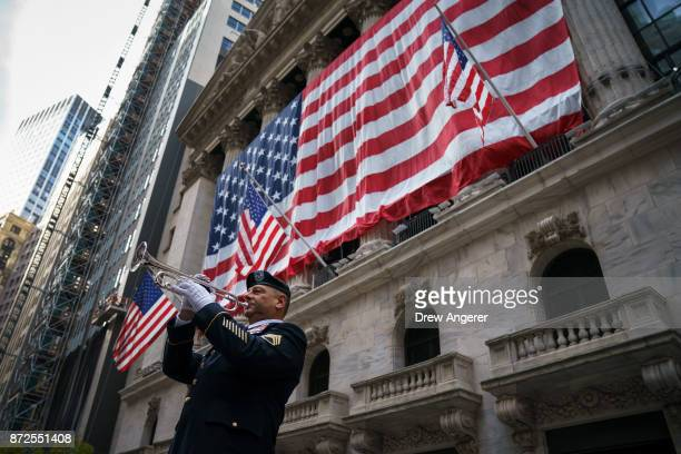 Mario Tronti a member of the 42nd Infantry Division of the US National Guard performs 'Taps' as an American flag is raised on the facade of the New...