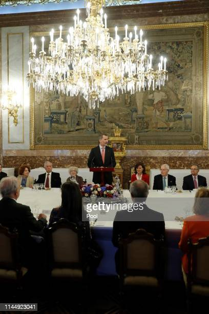 Mario Vargas Llosa, Ida Vitale, King Felipe VI of Spain and Carmen Calvo attend a luncheon for world literature members celebrating Vitale being...