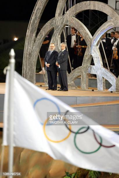 Mario Vazquez Raña President of the ODEPA and José Joaquin Cuello President of the Dominican Republic Olympic Comitee stand behind the olympic flag...
