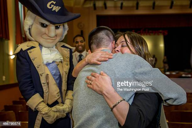 Mario Velasquez a senior at Benjamin Banneker Academic High School gets a hug from his mom Doris after he was surprised at school with a...