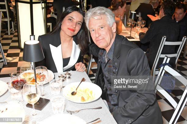 Mario Vieira de Carvalho and Adam Clayton attend 'Hermes Step Into The Frame' at Nine Elms on March 21 2019 in London England