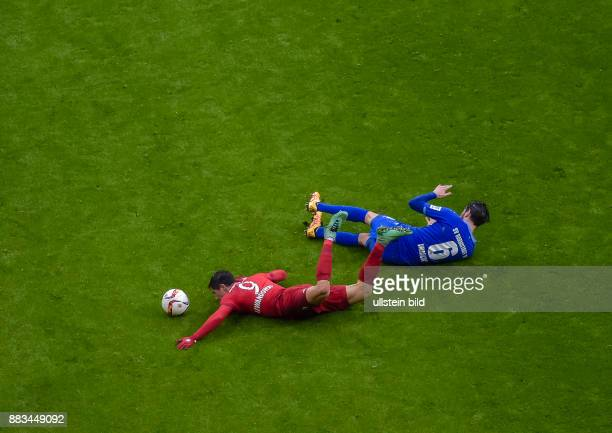 Mario Vrancic im Zweikampf mit Robert Lewandowski waehrend dem Fussball Bundesliga Spiel FC Bayern Muenchen gegen SV Darmstadt 98 am 22 Spieltag der...