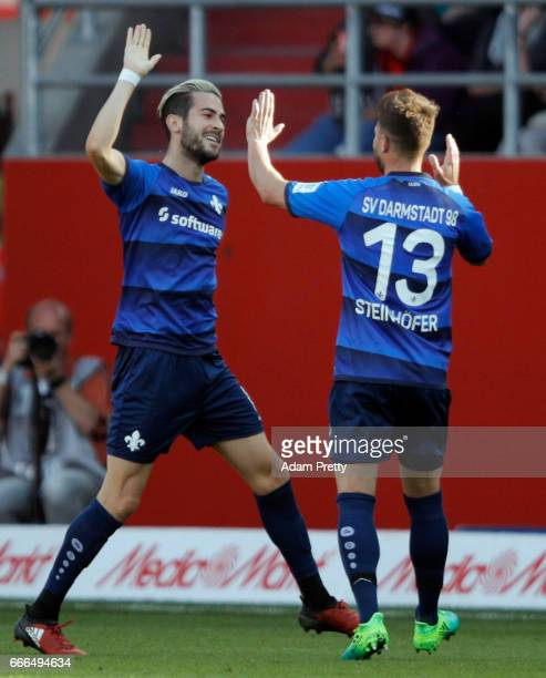 Mario Vrancic of Darmstadt celebrates his team's first goal with team mate Markus Steinhoefer during the Bundesliga match between FC Ingolstadt 04...