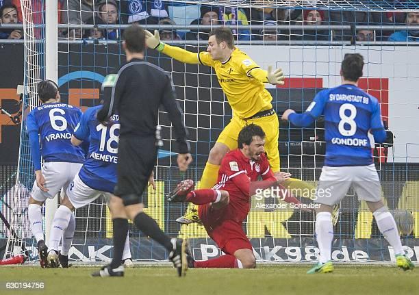 Mario Vrancic of Darmstadt pushs Mats Hummels of Bayern Muenchen during to the Bundesliga match between SV Darmstadt 98 and Bayern Muenchen at...