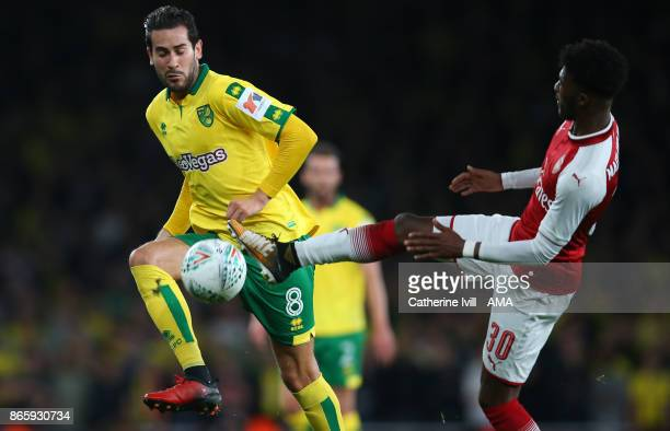 Mario Vrancic of Norwich City and Ainsley MaitlandNiles of Arsena during the Carabao Cup Fourth Round match between Arsenal and Norwich City at...