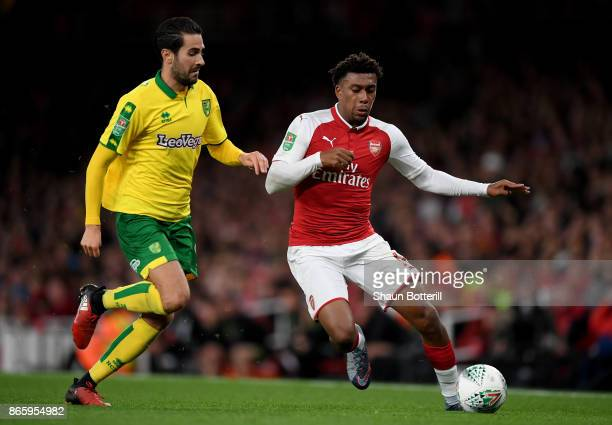 Mario Vrancic of Norwich City and Alex Iwobi of Arsenal during the Carabao Cup Fourth Round match between Arsenal and Norwich City at Emirates...