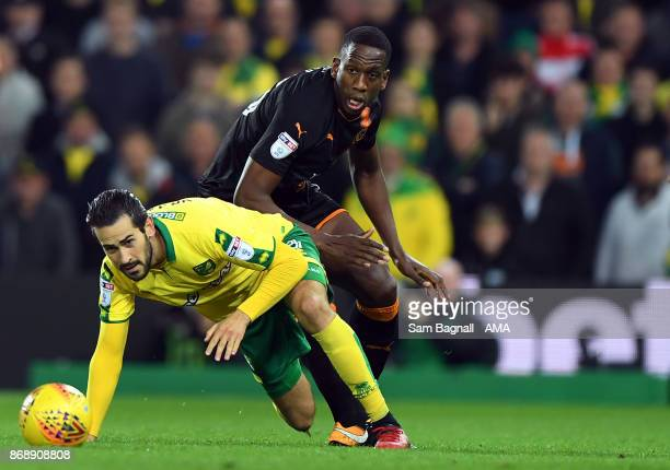 Mario Vrancic of Norwich City and Willy Boly of Wolverhampton Wanderers during the Sky Bet Championship match between Norwich City and Wolverhampton...