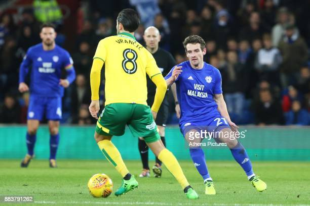 Mario Vrancic of Norwich City is marked by Craig Bryson of Cardiff City during the Sky Bet Championship match between Cardiff City and Norwich City...