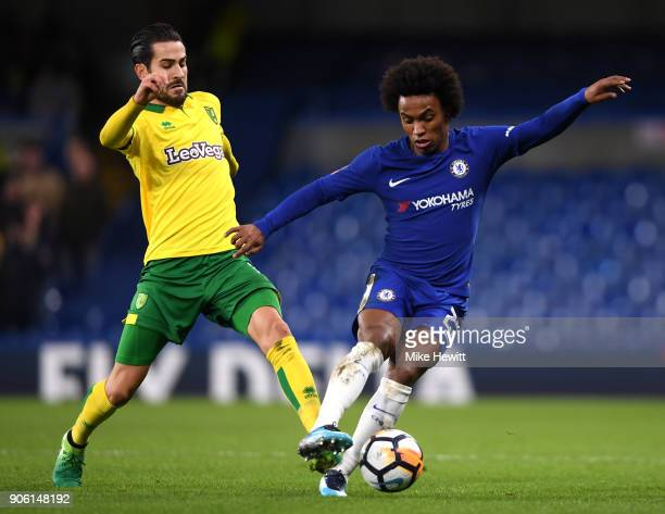 Mario Vrancic of Norwich City tackles Willian of Chelsea during The Emirates FA Cup Third Round Replay between Chelsea and Norwich City at Stamford...