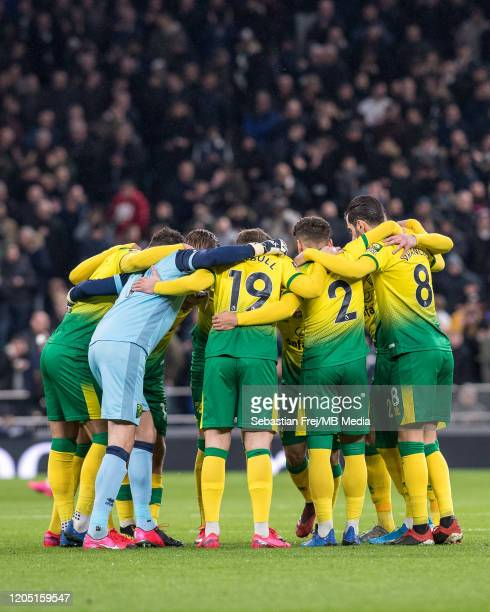 Mario Vrancic Tom Trybull Tim Krul Emi Buemdia Max Aarons Grant Hanley Jamal Lewis and Marco Stiepermann of Norwich City huddle during the FA Cup...