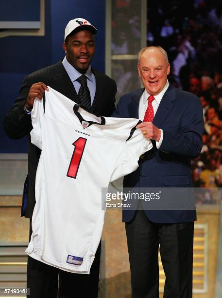Mario Williams a defensive end from North Carolina State and the Houston Texans owner Bob McNair hold up a jersey after the Texans selected Williams...