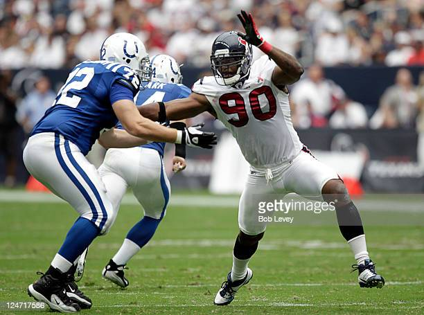 Mario Williams of the Houston Texans battles with offensive tackle Jeff Linkenbach of the Indianapolis Colts during the seasonopening game at Reliant...