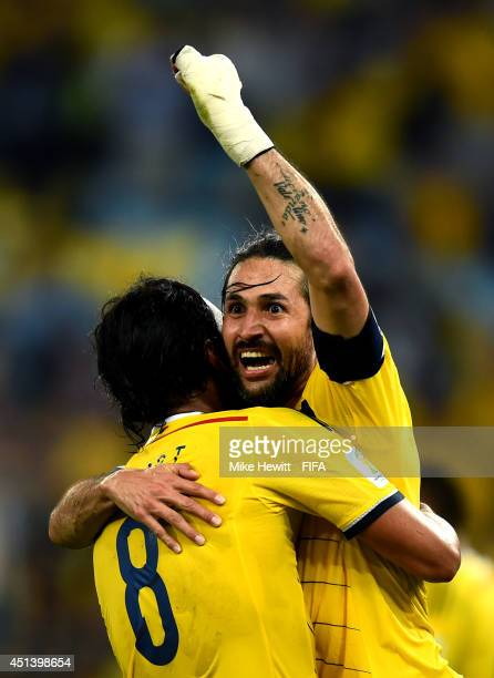 Mario Yepes and Abel Aguilar of Colombia celebrate the 20 win after the 2014 FIFA World Cup Brazil Round of 16 match between Colombia and Uruguay at...