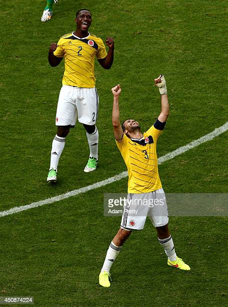 Mario Yepes and Cristian Zapata of Colombia celebrate a 21 victory in the 2014 FIFA World Cup Brazil Group C match between Colombia and Cote D'Ivoire...