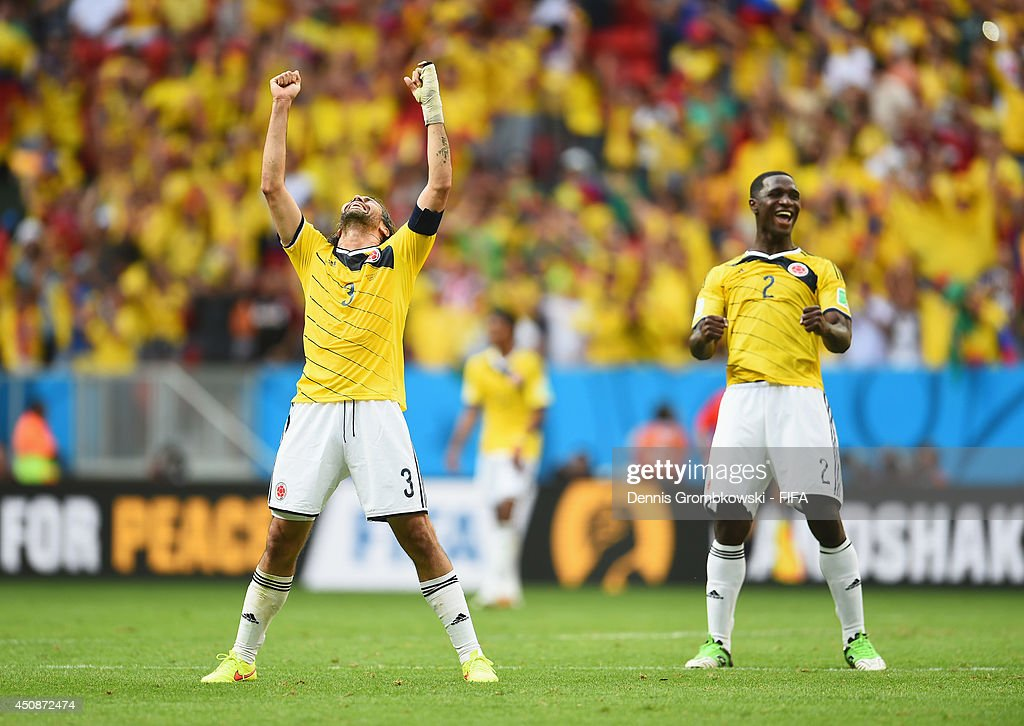 Mario Yepes (L) and Cristian Zapata of Colombia celebrate the 2-1 win after the 2014 FIFA World Cup Brazil Group C match between Colombia and Cote D'Ivoire at Estadio Nacional on June 19, 2014 in Brasilia, Brazil.