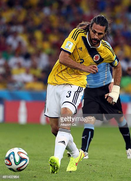 Mario Yepes of Colombia passes the ball during the 2014 FIFA World Cup Brazil Round of 16 match between Colombia and Uruguay at Maracana on June 28...