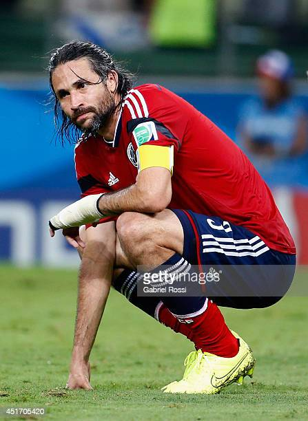 Mario Yepes of Colombia reacts after being defeated by Brazil 21 during the 2014 FIFA World Cup Brazil Quarter Final match between Brazil and...