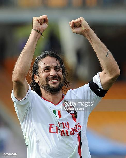 Mario Yepes of Milan celebrates victory after the Serie A match between US Lecce and AC Milan at Stadio Via del Mare on October 23 2011 in Lecce Italy