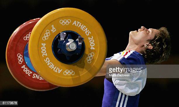 Marioara Munteanu of Romania competes in the women's 53 kg category weightlifting competition on August 15 2004 during the Athens 2004 Summer Olympic...