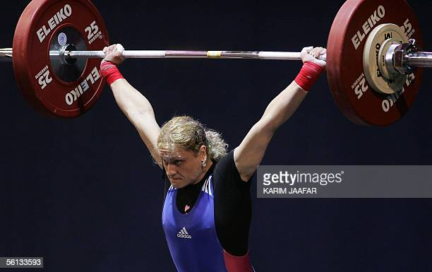 Marioara Munteanu of Romania lifts during the women's 53kg category in the World Weightlifting Championships in Doha Qatar 10 November 2005 The...