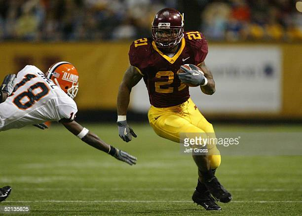 Marion Barber III of the Minnesota Gophers attempts to evade Alan Ball of the Illinois Fighting Illini during the game at the Hubert H Humphrey...
