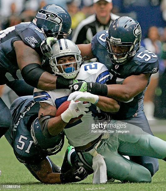 Marion Barber is hit in the first quarter by Will Herring Lofa Tatupu and Darrell Tapp as the Dallas Cowboys beat the Seattle Seahawks 349...