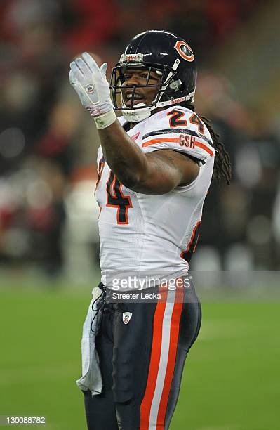Marion Barber of the Chicago Bears celebrates a touchdown during the NFL International Series match between Chicago Bears and Tampa Bay Buccaneers at...