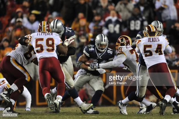 Marion Barber of the Dallas Cowboys runs the ball during the game against the Washington Redskins at FedExField on December 27 2009 in Landover...