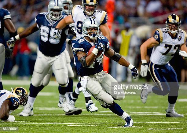 Marion Barber of the Dallas Cowboys runs with the ball against the St Louis Rams during their NFL game at Edward Jones Dome on October 19 2008 in St...