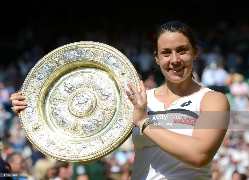 Marion Bartoli celebrates with her trophy after beating Sabine Lisicki in the Ladies Singles Final on Day 12 of the Wimbledon Lawn Tennis Championships at the All England Lawn Tennis and Croquet Club on July 6, 2013 in London, England.