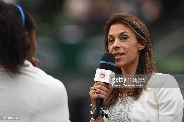 Marion Bartoli interviews Serena Williams of the United States following her victory during the Ladies Singles quarter final match against Yulia...