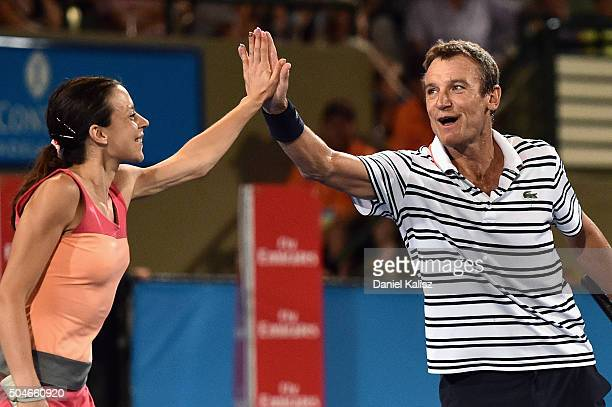 Marion Bartoli of France and Mats Wilander of Sweden react during the 2016 World Tennis Challenge doubles match between Mark Philippoussis of...
