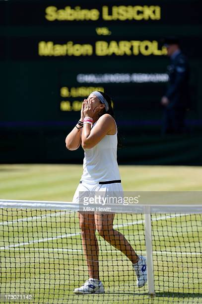 Marion Bartoli of France celebrates championship point during the Ladies' Singles final match against Sabine Lisicki of Germany on day twelve of the...