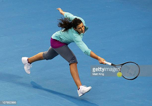 Marion Bartoli of France plays a backhand during her 1st round match against Dinara Safina of Russia during day two of the Moorilla Hobart...