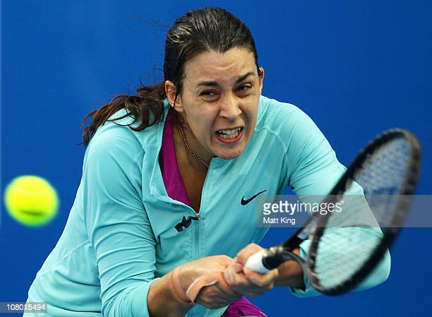Marion Bartoli of France plays a backhand during her 2nd round match against Elena Vesnina of Russia during day five of the Moorilla Hobart...