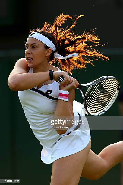 Marion Bartoli of France plays a backhand during her Ladies' Singles second round match against Christina Mchale of the United States of America on...