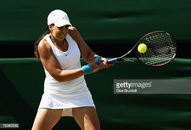 Marion Bartoli of France plays a backhand during the Women's Singles final match against Venus Williams of USA during day twelve of the Wimbledon...