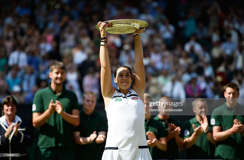Marion Bartoli of France poses with the Venus Rosewater Dish trophy after her victory in the Ladies' Singles final match against Sabine Lisicki of Germany on day twelve of the Wimbledon Lawn Tennis Championships at the All England Lawn Tennis and Croquet Club on July 6, 2013 in London, England.