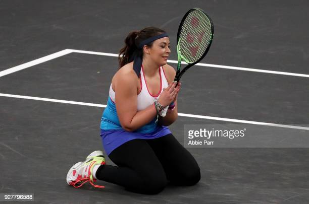 Marion Bartoli of France reacts while playing against Serena Williams in the first round during the Tie Break Tens at Madison Square Garden on March...