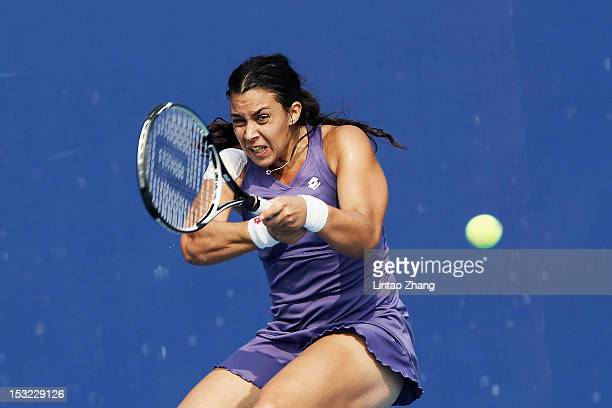 Marion Bartoli of France returns a shot to Ayumi Morita of Japan during the Day 4 of China Open at the China National Tennis Center on October 2 2012...